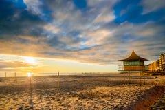 Glenelg Beach at sunset. Surf life saving tower at Glenelg Beach, South Australia Stock Photography