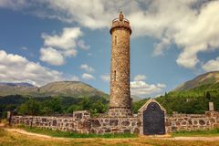 Glenfinnan monument, column topped by a highlander with kilt. Co. Mmemorates the beginning of the Jacobean military campaign. The place located at the northern royalty free stock photo