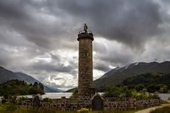 Glenfinnan Monument and Loch Shiel lake. Highlands Scotland Uk. Glenfinnan Monument and Loch Shiel lake on a cloudy day. Highlands Scotland Uk Stock Image
