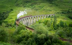 Glenfinnan Railway Viaduct with the Jacobite steam, in Lochaber area of the Highlands of Scotland. Glenfinnan is a hamlet in Lochaber area of the Highlands of stock photography