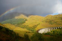 Glenfinnan Viaduct Scotland Panorama With Rainbow Extra Wide in Great Britain royalty free stock photo