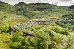 Glenfinnan viaduct with steam train Royalty Free Stock Image