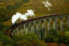 Glenfinnan viaduct. With train from Harry Potter movie Stock Photography