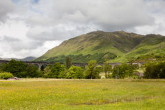 Glenfinnan Viaduct. A view of Glenfinnan Viaduct on the West Highland Line in Scotland between Fort William and Mallaig.  The railway viaduct has featured in Stock Photos