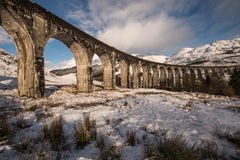 Glenfinnan viaduct in winter, Scotland. Impressive viaduct in Scotland: the Glenfinnan viaduct. This is the viaduct of the famous film Harry potter Winter Royalty Free Stock Photography