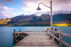 Glenorchy wharf wooden pier and lamp after sunrise Stock Photo