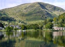 Glenridding Lake District, from Ullswater. Birkhouse Moor behind, heavy reflection in lake stock photography