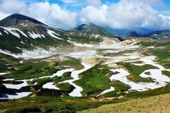 Gletscher zwischen Bergen Stockfotografie