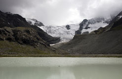 Gletsjer Switserland lake the moiry. With high mountains and snow and ice Stock Photos