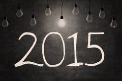 Glühlampe und Zahl von 2015 Stockbild