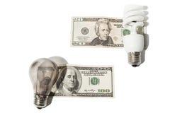 Glühlampen auf Geld Lizenzfreies Stockbild