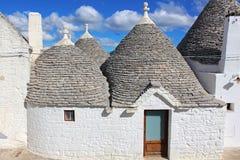 Gli agricoltori anziani di modo hanno sviluppato le loro case in Puglia Fotografia Stock