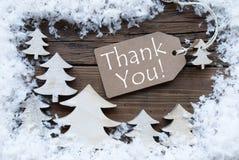 Gli alberi di Natale e la neve dell'etichetta vi ringraziano Fotografia Stock