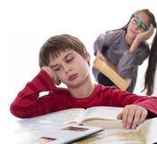 Gli allievi pigri, libri possono essere molto noiosi Fotografia Stock