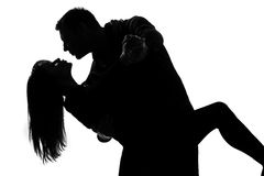 Gli amanti uomo dell'una coppia e tango di dancing della donna fotografia stock