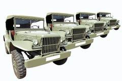Gli anni 40 militari delle automobili dell'annata nella riga Fotografia Stock Libera da Diritti