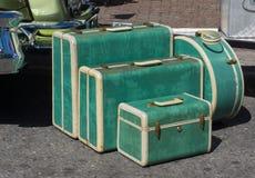 Gli anni 50 stabiliti della retro valigia dei bagagli Immagini Stock