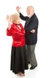 Gli anziani ballano la notte via Fotografia Stock
