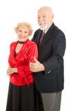 Gli anziani di Dancing sfoglia in su Fotografia Stock