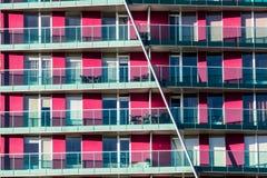 Gli appartamenti porpora del blocco Fotografia Stock