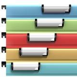 Gli archivi colorati con la copia spaziano disponibile sui bolli in bianco Immagine Stock