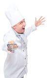 Gli attacchi pazzi del cuoco allegro della cucina spalano su un bianco Fotografie Stock Libere da Diritti