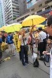 Gli attivisti 2015 di Hong Kong marciano davanti al voto sul pacchetto elettorale Fotografie Stock