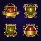 Gli emblemi araldici reali di vettore nello stile vittoriano con la corona, lo schermo e l'alloro dorati si avvolgono illustrazione vettoriale