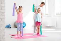 Gli esercizi vi renderanno forte! fotografia stock