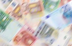 Gli euro soldi delle denominazioni differenti blured il fondo Immagine Stock Libera da Diritti