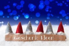 Gli Gnomi, fondo blu, Bokeh, Geschenk Ideen significa le idee del regalo Immagine Stock