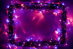 Gli indicatori luminosi di Natale incorniciano il contesto Fotografie Stock Libere da Diritti