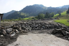 Gli infangamenti sfregiano i pendii di collina dell'Austria che seguono la pioggia persistente Fotografia Stock Libera da Diritti