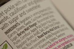 Gli ingredienti del barattolo dell'alimento hanno evidenziato gli allergeni Fotografia Stock Libera da Diritti