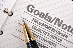 Gli obiettivi paginano in taccuino Fotografie Stock