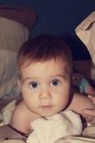 Gli occhi dell'infanzia fotografia stock