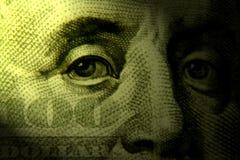 Gli occhi di soldi Fotografie Stock Libere da Diritti