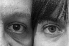 Gli occhi di una donna e di un uomo Fotografia Stock Libera da Diritti