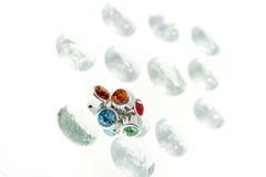 Gli orecchini del diamante hanno isolato Fotografie Stock
