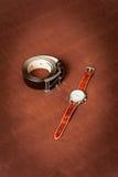 Gli orologi e la cinghia degli uomini Fotografie Stock