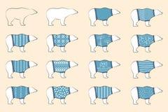 Gli orsi bianchi indossano i pollovers blu della lana Orsi polari messi Orsi nordici in maglioni caldi ornamentali Progettazione  royalty illustrazione gratis