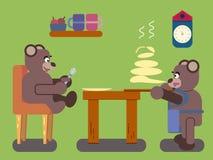 Gli orsi bruni del fumetto prepara i pancake Fotografie Stock