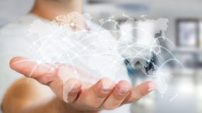 Gli scambi '3D della rete globale e di dati della tenuta dell'uomo d'affari si strappano Fotografia Stock Libera da Diritti