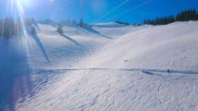 Gli sciatori sul pendio nevoso di Zwolferhorn, st Gilden, Austria