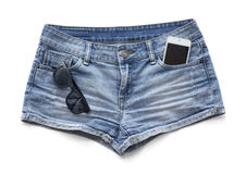 Gli shorts delle donne delle blue jeans Immagine Stock