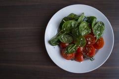Gli spinaci ed i pomodori Immagine Stock Libera da Diritti
