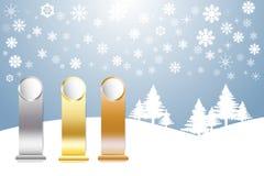 Gli sport dorati, d'argento e bronzati si allineano nel paesaggio della neve dell'inverno Immagine Stock