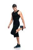 Gli sport equipaggiano l'allungamento delle gambe Immagini Stock Libere da Diritti