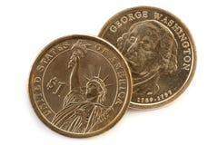 Gli Stati Uniti lle monete dell'un dollaro fotografie stock