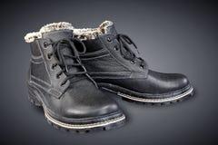 Gli stivali degli uomini di cuoio neri fotografia stock
